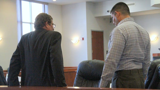 In this 2017 file photo, Joe D. Chavez Sr. talks to defense attorney George A. Harrison during a break in Chavez's 2017 trial in 12th Judicial District Court.