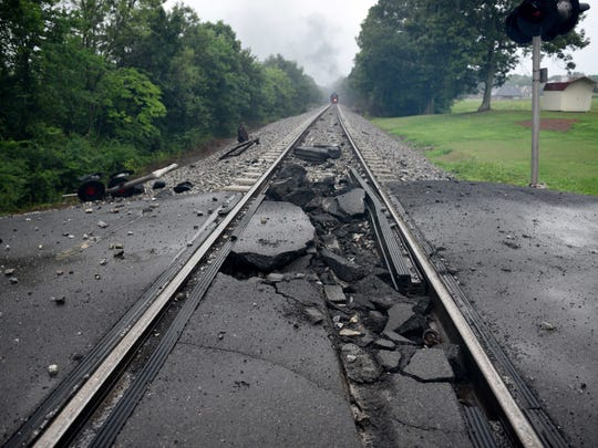 A CSX train torn down one light post and the intersection where it crosses Mount Tabor Road in Blount County  Thursday, Jul. 2, 2015. CSX is working with first responders and relief agencies in Maryville following the derailment of a tank car that is on fire. CSX personnel are on hand at an Outreach Center that has been established at Heritage high school. (MICHAEL PATRICK/NEWS SENTINEL)