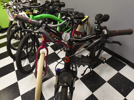 Row of electric bicycles available at Freedom Bicycles