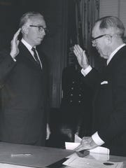 George Edwards, Commissioner of Police, taking oath of office from Thomas Leadbetter, City Clerk in 1962.