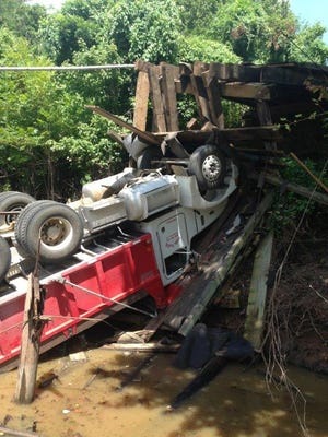 The driver of this truck sustained non-life-threatening injuries when a bridge collapsed while he was driving across it on Tuesday afternoon.