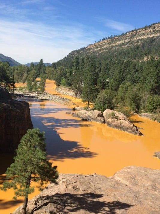 This photo from the La Plata County, Colo., website shows mine pollution released into the Animas River from a location above Silverton, Colo. The photo was taken at a spot north of Durango, Colo.