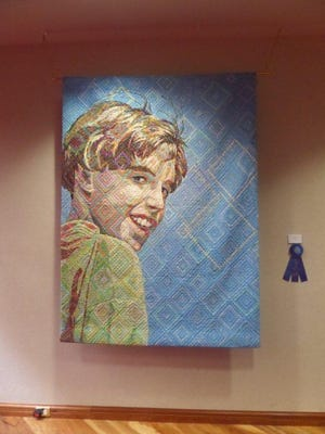 The 23rd Annual Canton Fine Arts Exhibition 2015 Best of Show is Sam in Sunlight by Deborah S. Hyde of West Bloomfield. The exhibit continues through Oct. 28.