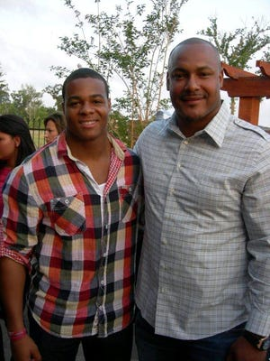 Pierre Thomas and Will Smith in 2011.
