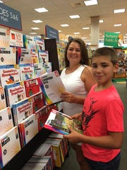 Jackie Malle and son Damion selecting study guides at Barnes & Noble for Damion to brush up on what he learned last year.