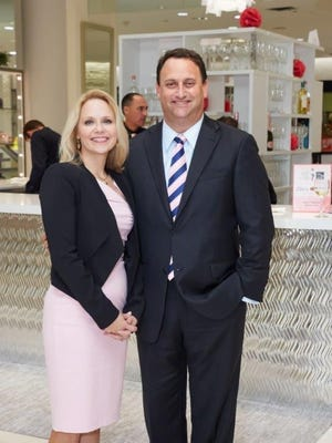 Liv E. Vesely, president of the Jupiter Medical Center Foundation, stands with John D. Couris, Jupiter Medical Center president and CEO, at the 18th annual Key to the Cure event held at Saks Fifth Avenue at The Gardens Mall, in Palm Beach Gardens, on Oct. 26.