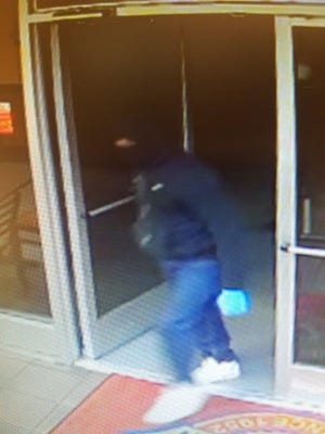 Surveillance photo from the armed robbery of a Church's Chicken on E. 70th in Shreveport.