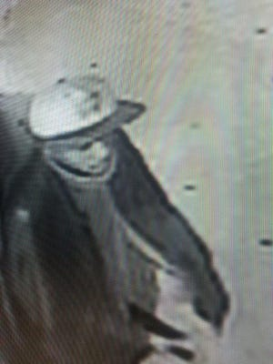 Surveillance photo of armed robbery suspect who hit a Little Ceasar's in Shreveport.