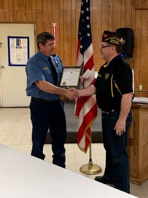 Shawnee firefighter Richard Stevenson receiving the VFW Firefighter of the Year from State Serviceman James.Dockemeyer.