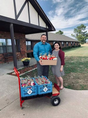 Isaac Brown if Brown's Family Funeral Home and Our Little Flowers with his wife Conner as they deliver flowers to the residents of McLoud Nursing Center.