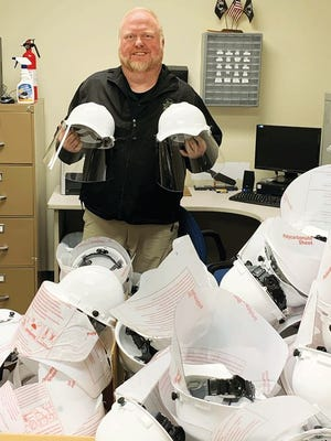 Sheriff Russell Barker and the county Sheriff's Department received helmets designed by County Commissioner Tim Isbel.