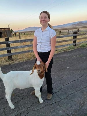 Brooke Bradford shows off Vincent Van Goat.