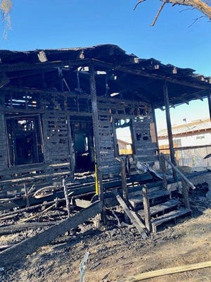 The aftermath of a fire that burned a home in Trona on July 26 is shown. One person was displaced by the fire, but firefighters were able to keep the blaze from spreading to the surrounding houses.
