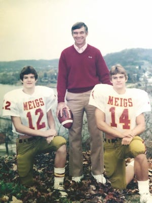 Charles Chancey (center) duirng his Meigs County football coaching days.