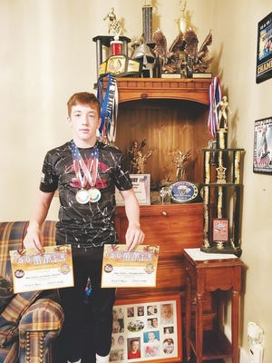 Robert Shockey displays his certificates and medals from his recent National Championships in Myrtle Beach, South Carolina.