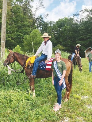 Cowboy Tony Jones made a stop in Ripley to spread his message and speak with veterans. Pictured is Jones on his horse with 2020 Miss Ripley Fourth of July Courtney Winter.