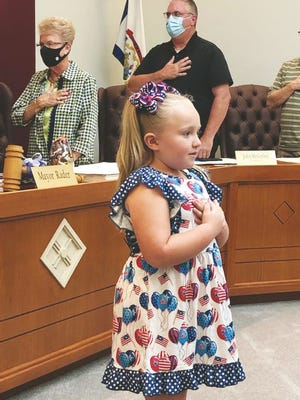 Claire Racer, five years old, leads the Ripley City Council in the Pledge of Allegiance.