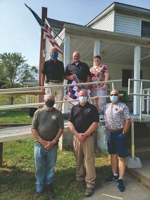 The addition of a wheelchair ramp is what Burton Lyons had hoped for for several years. Thanks to BK20 #BKATHome, his hope became a reality. Pictured from front to back, left to right are: Jackson County Hunting Heroes Bob Frame, Jackson County EMS director Troy Bain, and Parchment Valley Conference Center director Frank Miller. Back row: Epworth United Methodist Church pastor Ford Price, veteran Burton Lyons, and Burton's wife Debora Lyons.