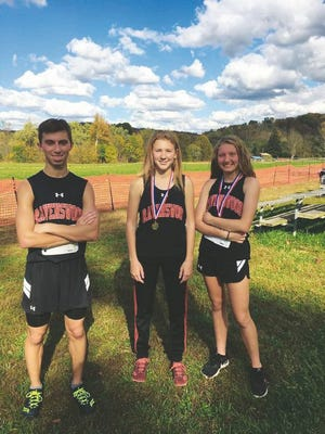 Ravenswood runners earning All-Regional, pictured from left to right, include Cade Curfman, Emily Wratchford, and Hadleigh McGoskey.