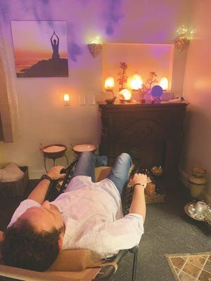 Ben Wilkes relaxes in the new Himalayan Salt Therapy Meditation room.