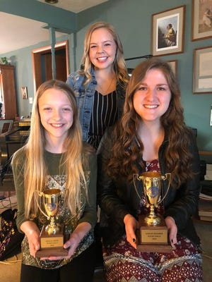 Grace LaVoy (front left), Sarah Kramer and Anna VanRiesen are being featured in the online piano recitals.