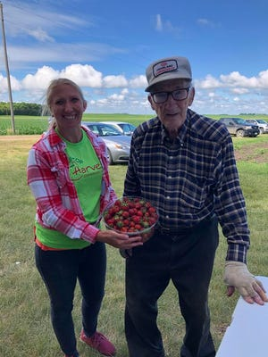 Leroy Schmidt from Wood Lake, who will soon be 101, stopped by Hilltop Harvest on Hunter Avenue west of Redwood Falls and posed with Katherine Brozek of Hilltop Harvest. Schmidt was proud to claim the designation as the oldest berry picker.