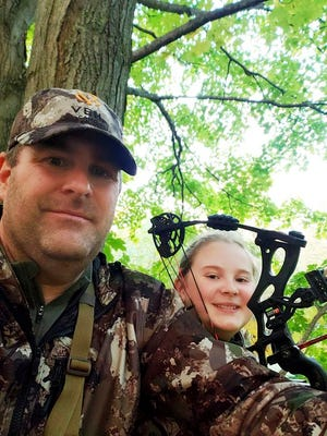 n this Oct. 10, 2020, photo provided by Zane Goucher is Goucher, left, and his daughter Annabelle Goucher bow hunting for deer near Dansville, Mich. Zane Goucher says he hadn't gone hunting in 22 years but took up the sport again because the coronavirus outbreak provided incentive to spend more time outdoors with his children.