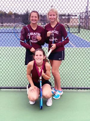 Osage's Marley Corpe and Megan Smithson (top) and Lily Davis (bottom) with their medals at the district tournament in Marshall on Saturday, October 3.