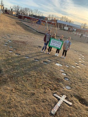 Girl Scout Troop 20028 members pose at St. Joseph's Catholic School, where their rosary project was finished.
