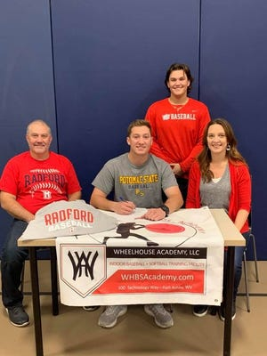 Zack Whitacre, surrounded by parents Seth and Keri Whitacre and brother Brady Whitacre, signed Friday to continue his baseball and academic careers at Division I Radford University.