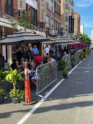 There were many people dining out recently along Hanover Street in the North End. The opening of restaurants in the state has given people a break from having to prepare their own meals during the Covid-19 pandemic.