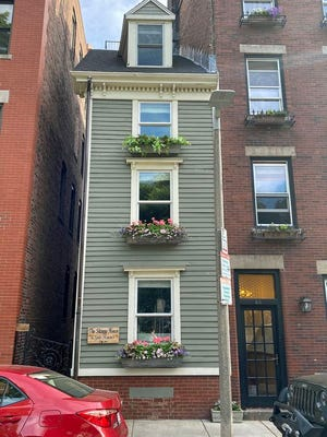"The Skinny House, also known as the Spite House, at 44 Hull St. is a very narrow four-story house in the North End. Its widest point is only 10.4 feet. There are only four doors in the entire home. The house was built as a ""spite house"" shortly after the American Civil War. One story says that two brothers inherited land from their deceased father. ""While one brother was away serving in the military, the other built a large home, leaving the soldier only a shred of property that he felt certain was too tiny to build on. When the soldier returned, he found his inheritance depleted and built the narrow house to spite his brother by blocking the sunlight and ruining his view,"" according to Wikipedia."