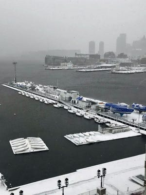 These boats aren't going anywhere after snow falls in the Charlestown Navy Yard.