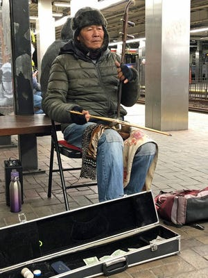 Luo is one of the musicians entertaining people in the Park Street MBTA station. The relaxing tone of his music certainly helps make waiting for trains easier.