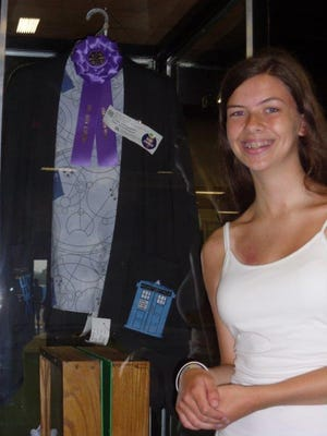 Jacyln Fischesser, 14, of California, displays her 4-H sewing project, a suit complete with a Doctor Who Tardis emblem, at the Kentucky State Fair in August 2014. Fischesser's project won the overall grand championship for all 4-H sewing projects.