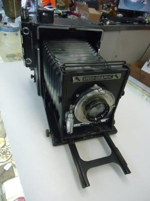 Vintage cameras, such as this Speed Graphic, are popular with collectors. Credit: Larry Cox