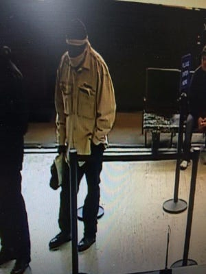 Port Chester police said that the man captured in this Chase Bank surveillance video robbed the branch of about $1,700 by handing a teller a note. The suspect is described as black, thin, around 25 to 35 years old and wearing a tan jacket and a dark cap.