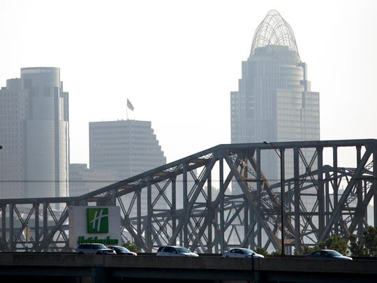 Cars pass through the Brent Spence Bridge on I-71/I-75, as the city is seen in the background in this 2011 file photo.