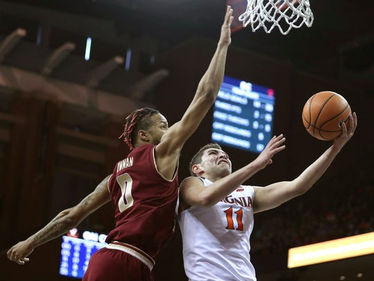 Virginia's Ty Jerome (11) shoots a lay up as Boston