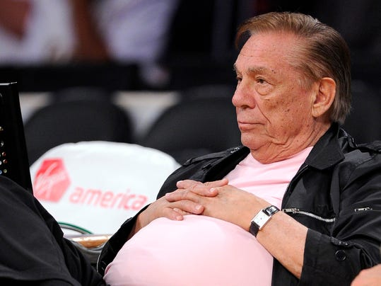 FILE - In this Oct. 17, 2010 file photo, Los Angeles Clippers team owner Donald Sterling watches his team play in Los Angeles. With a $2 billion sale of the Clippers hanging in the balance, a judge is set to determine Monday, June 30, 2014, if the terms of a family trust alone are enough to confirm Donald Sterling was properly removed as trustee and allow his estranged wife to sell the team without his consent.  (AP Photo/Mark J. Terrill, File)