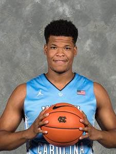 A slimmer but strong Kennedy Meeks poses for his team portrait Wednesday in Chapel Hill, N.C. during North Carolina men's basketball team's media day activities.