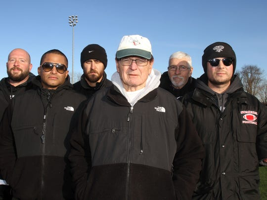 From left, Somers football coaches Mike Sokolofsky, Dom Narcisco, Doug Packard, Tony DeMatteo, Gerry Keevins, and Anthony DeMatteo, take a break from practice at Somers High School on Nov. 23, 2016, as they prepare for the Class A state championship game.