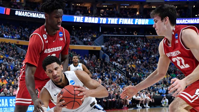 Villanova Wildcats guard Josh Hart tries to drive against Wisconsin forward Nigel Hayes (10) and forward Ethan Happ.