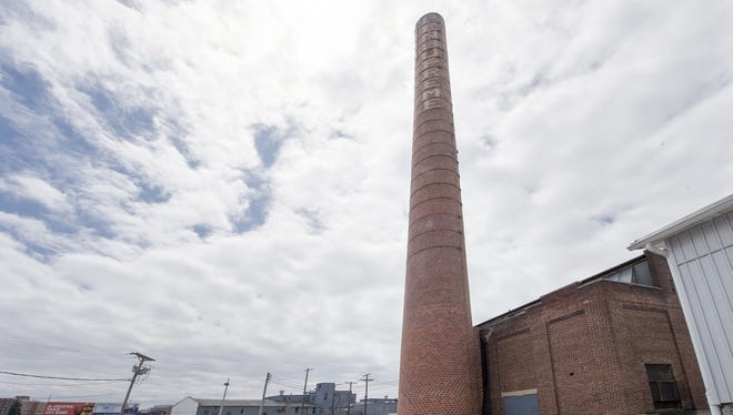 The Pensupreme Dairy smoke stack is shown July 5, 2016. The property associated with the old dairy, will be used as the site for a future high school for the York Academy Regional Charter School.
