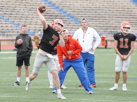 San Angelo Central High School offensive coordinator Kevin Crane watches quarterback Maverick McIvor during workouts this past spring. Crane helped develop McIvor into a Division-I quarterback. He verbally committed to play for Texas Tech in 2019.