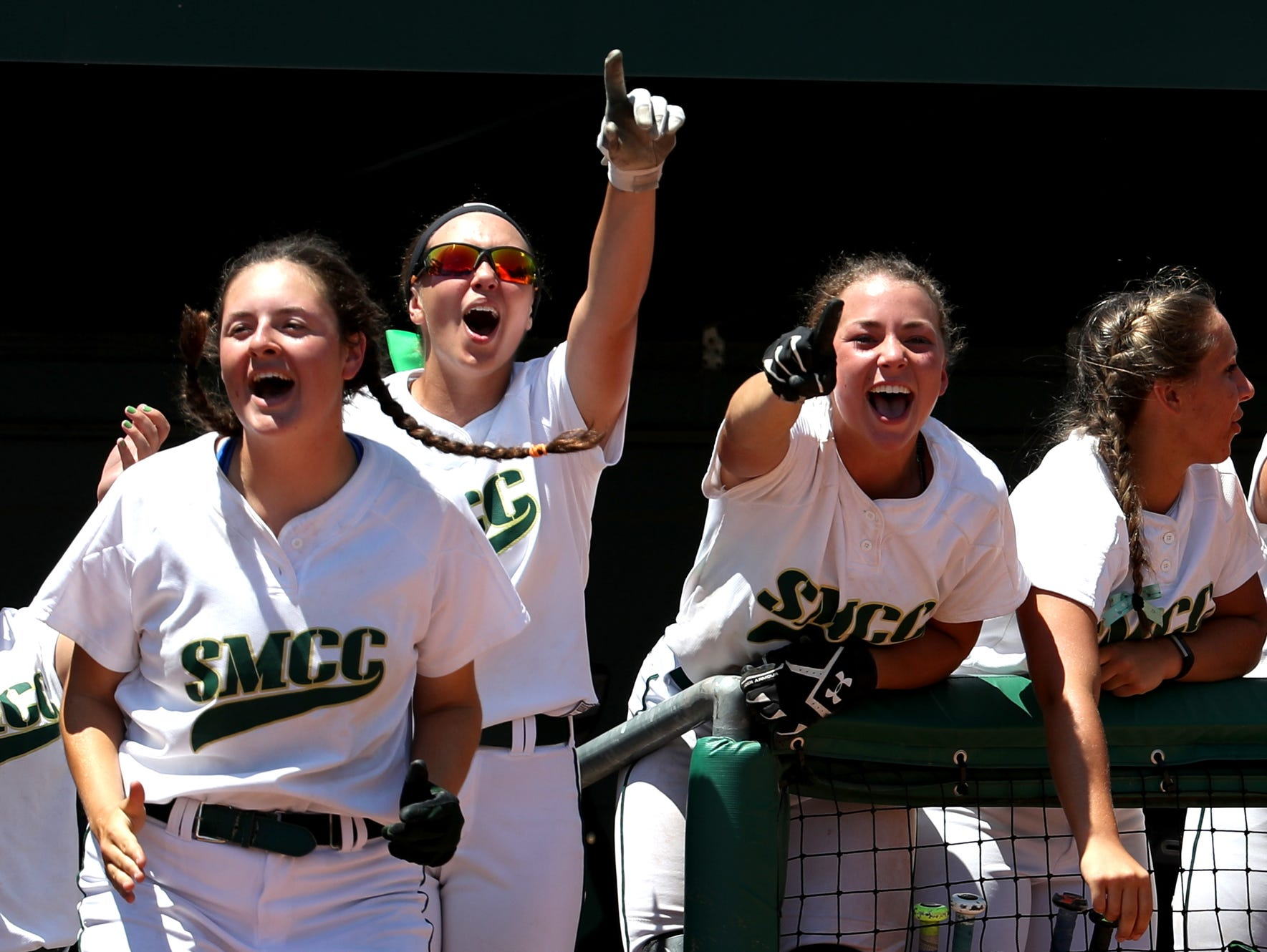 Monroe St. Mary players cheer on their team on the field during their game against Gladstone on Friday, June 17, 2016 at the MHSAA Division 3 softball semi finals at Michigan State University in East Lansing, Michigan. Monroe St. Mary's won the game 13-0 in 5 inning to reach the division 3 finals on Saturday.