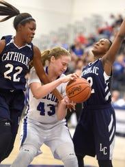 Cedar Crest's Alyssa Austin tries to wrestle a rebound