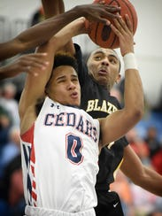 Lebanon's Shaquell Ortiz battles for a rebound during