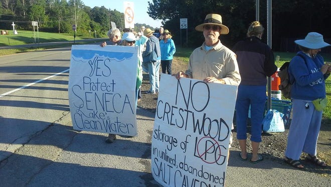 Protesters stand near the entrance to the Crestwood Midstream facility on state Route 14 in Schuyler County.