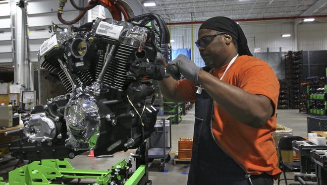 Harley-Davidson employee Michael Guster inspects a new Milwaukee-Eight engine before it's shipped from the manufacturing plant in Menomonee Falls.